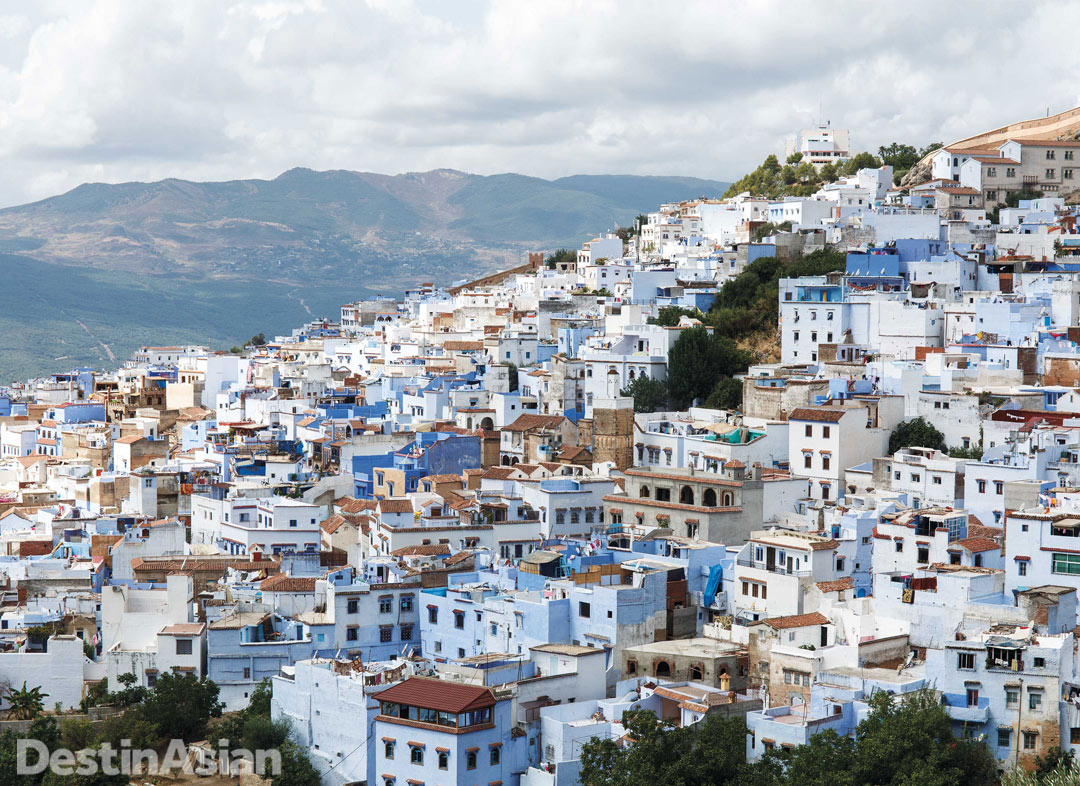 Chefchaouen's signature blue houses cascade down a hillside.