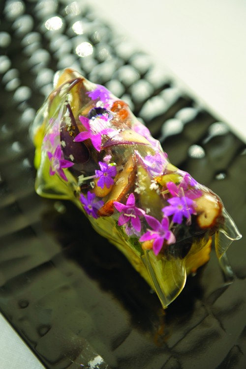 Sauteed Kyoto eggplant with shiitake mushrooms and edible flowers overlaid with a film of tomato jelly.