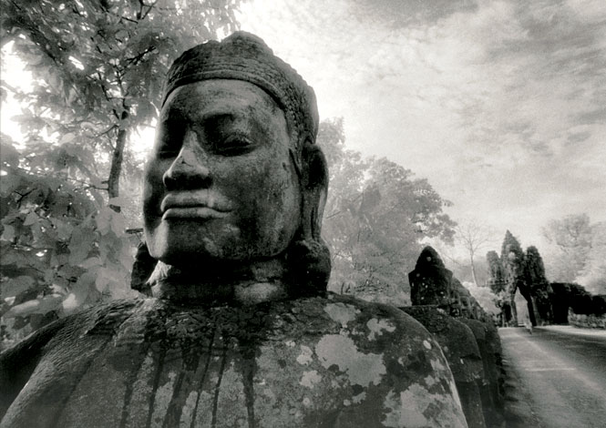 One of the 54 stone gods that flank the causeway leading to the south gate of Angkor Thom.