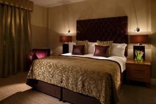 The cozy, elegant bed.