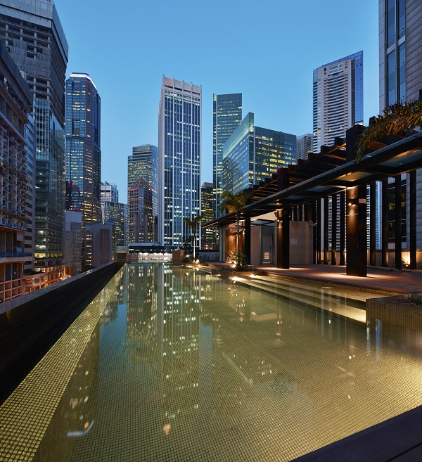 The hotel's rooftop pool and bar offers low-rise views of the surrounding CBD skyscrapers.