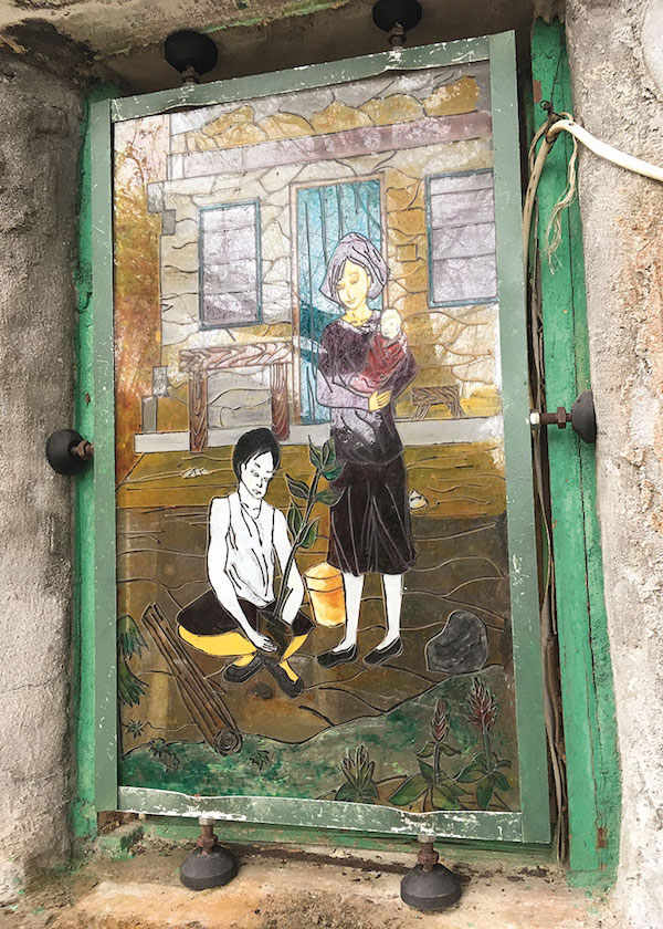 A painted glass window on a village house at Yim Tin Tsai. Photo by the author.