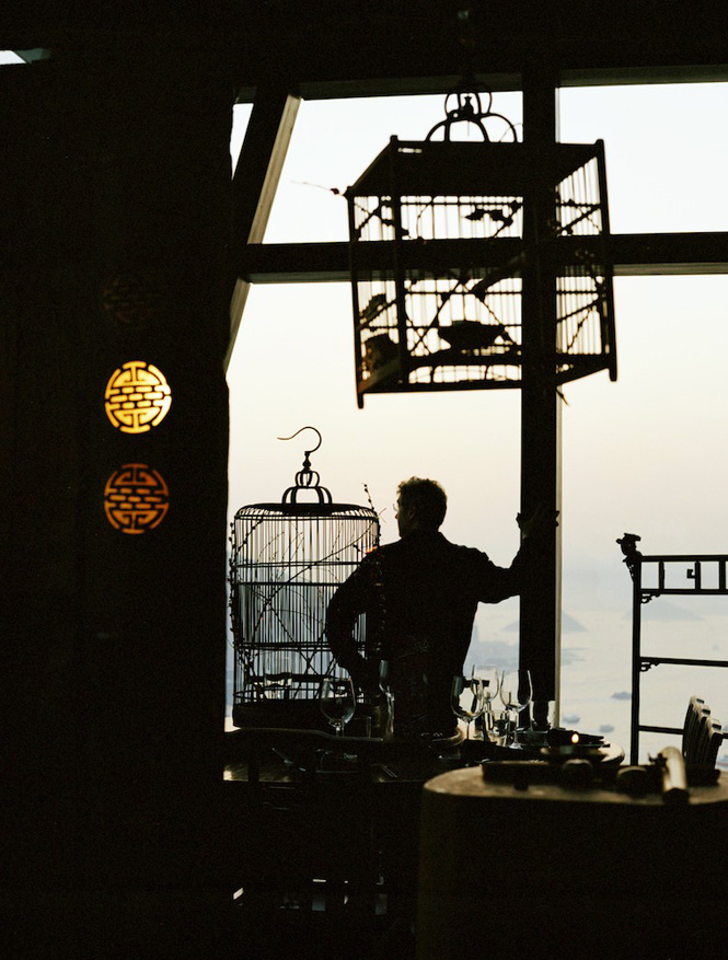 Antique birdcages feature in the mod-Chinese decor of Hutong restaurant.