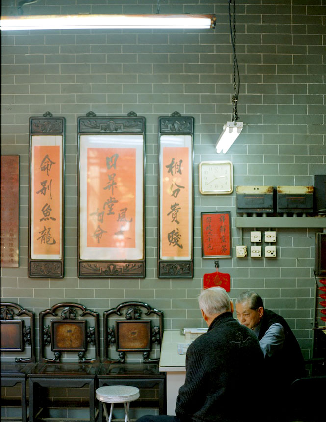 Neighborhood Seniors Deep in Conversation at The Entrance to Kowloon's Tin Hau Temple.