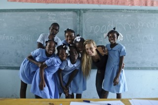 Petra Nemcova with students at one of the seven schools in Haiti she helped rebuild following the 2010 earthquake.