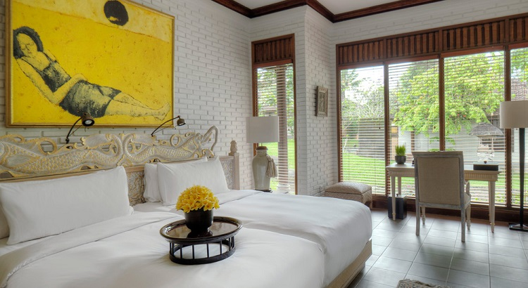 The guest bedroom is equally spacious and serene which overlooks the resort's manicured gardens.