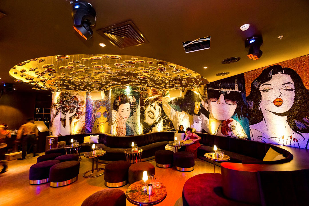 Pop art murals grace the interior at Camelia Lounge.