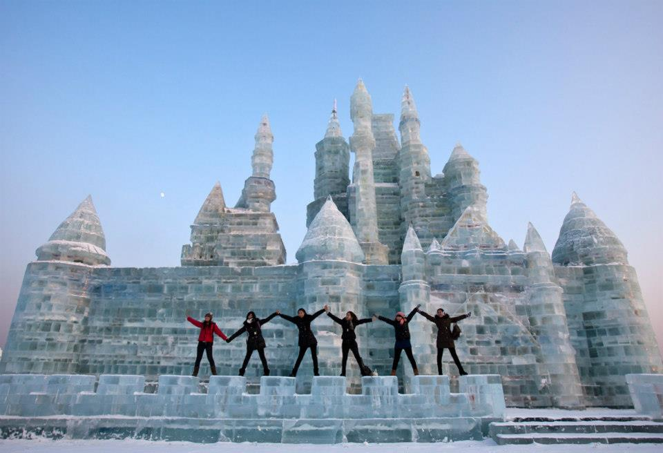 Revelers at an ice castle at the Harbin Ice and Snow Festival.