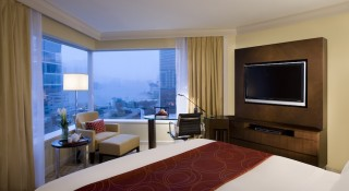 A Harbour View Room at the hotel features marble bathrooms and views of Victoria Harbour.