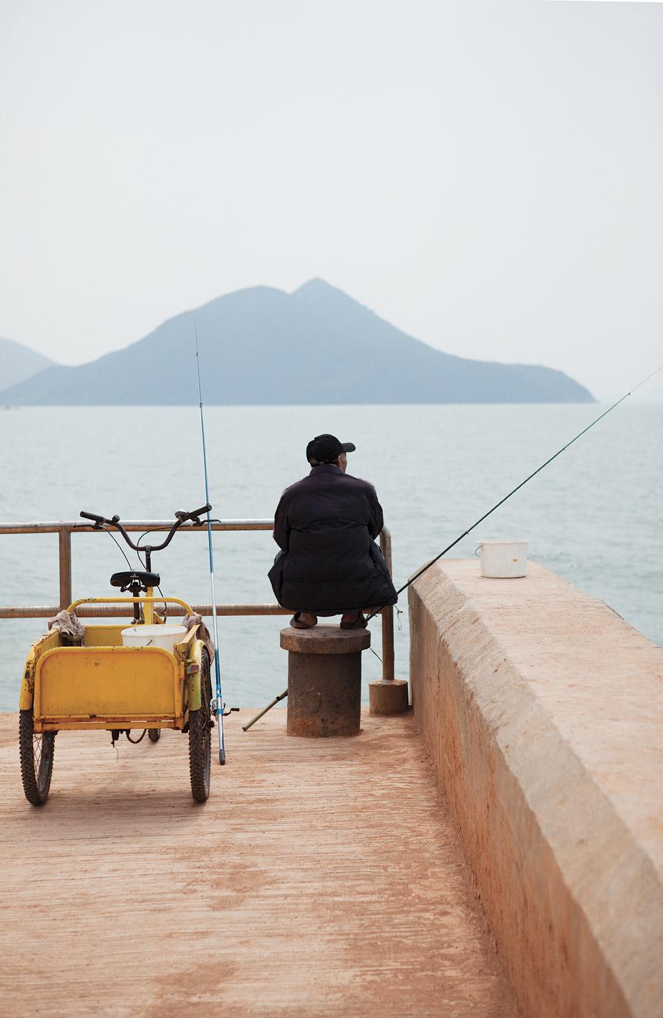 Waiting for a bite on the village's Shek Tsai Po Pier.
