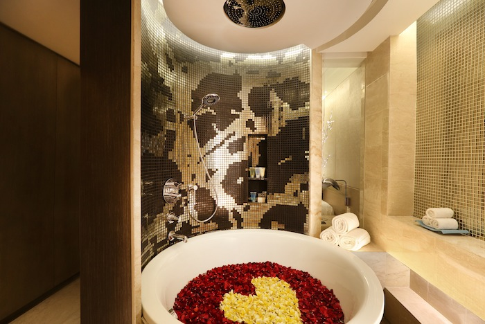 Shimmering gold and brown tiles add a touch of glamour to bathrooms.