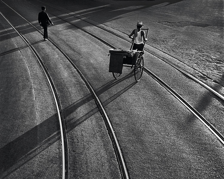A rickshaw driver crossing Central's tramlines in 1966 is pictured in End of the Day.