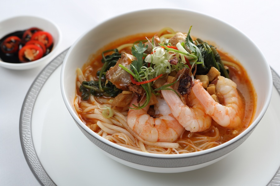 Hokkien mee soup is filled with rice noodles, bean sprouts, egg, and prawns.