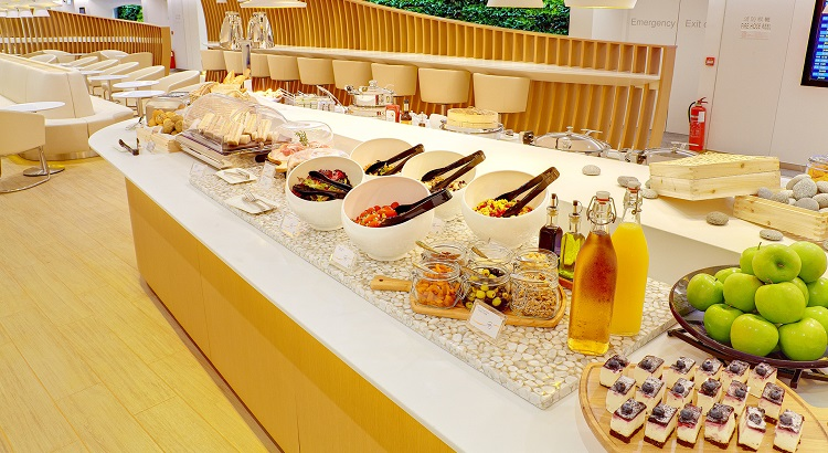 A hot and cold buffet area for international cuisine.