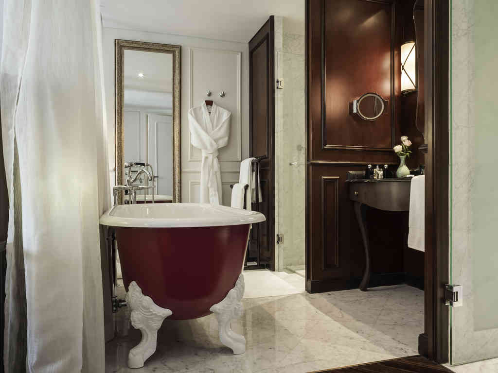 A view of the bathroom at one of Hotel des Arts Saigons rooms.