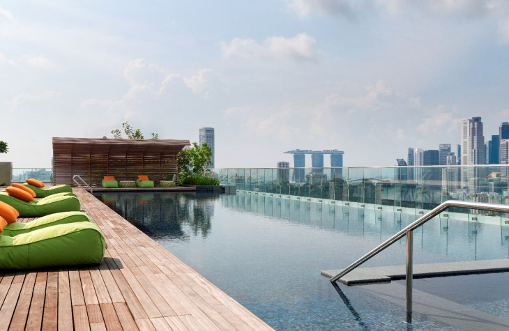 The rooftop pool at Hotel Jen Orchardgateway Singapore with a view of Marina Bay Sands in a distance.