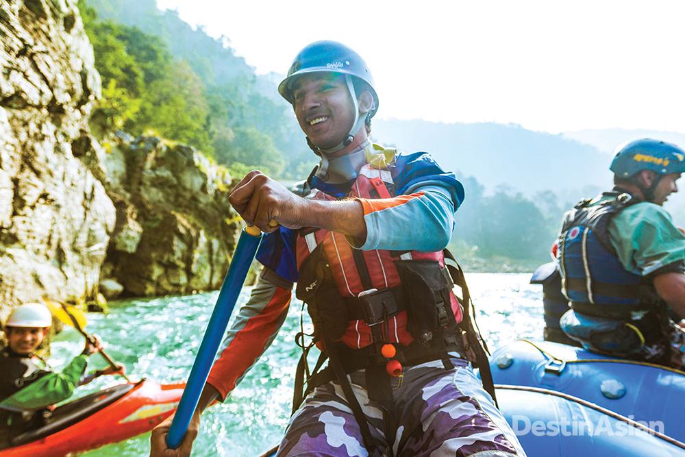 Aquaterra guide Sohan Singh Rana leading guests through a run of white water.