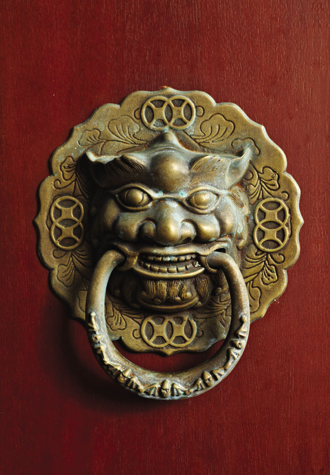 Design details like this door knocker reference the imperial architecture of Hue.