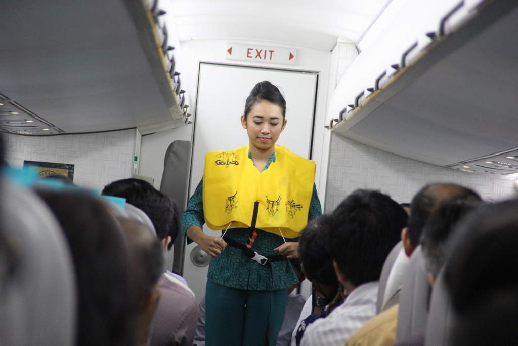 A Garuda flight attendant in action.