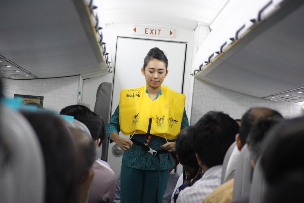 A Garuda flight attendant in action.