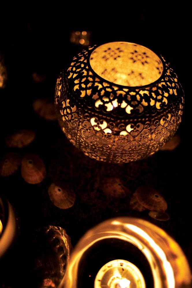 Candle lanterns shed soft light on Hud Hud Travels' desert camps.