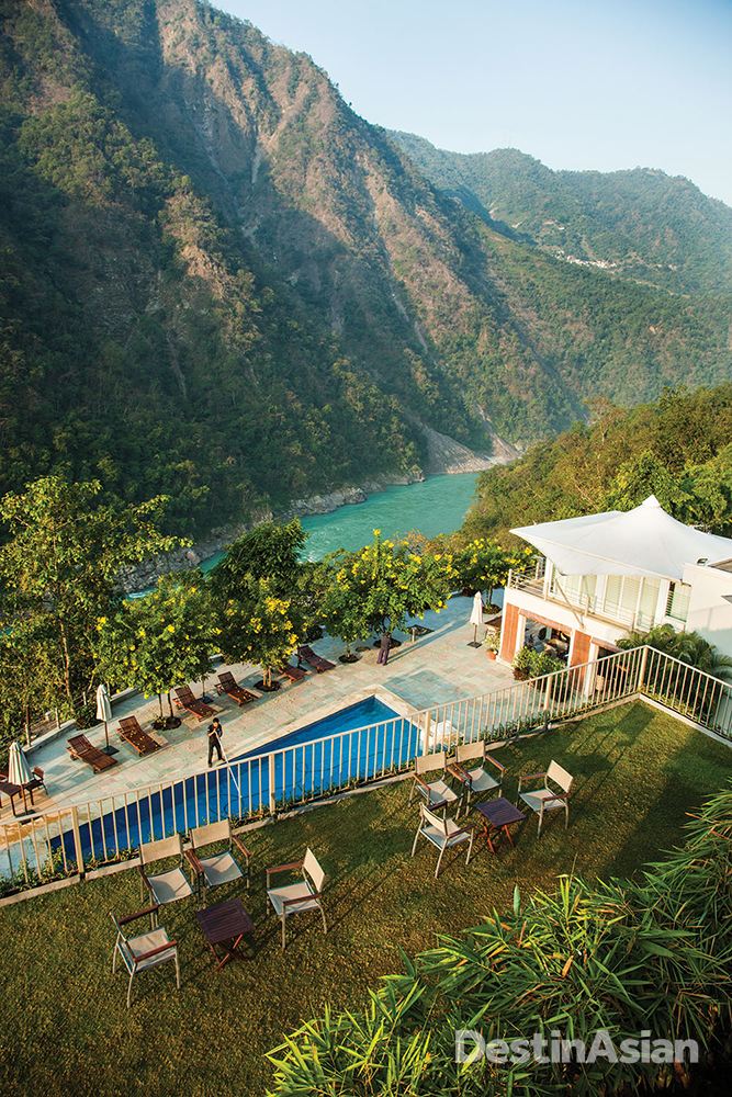Terraced down a hillside above the Ganges, Atli Ganga features amenities such as a 14-meter swimming pool.