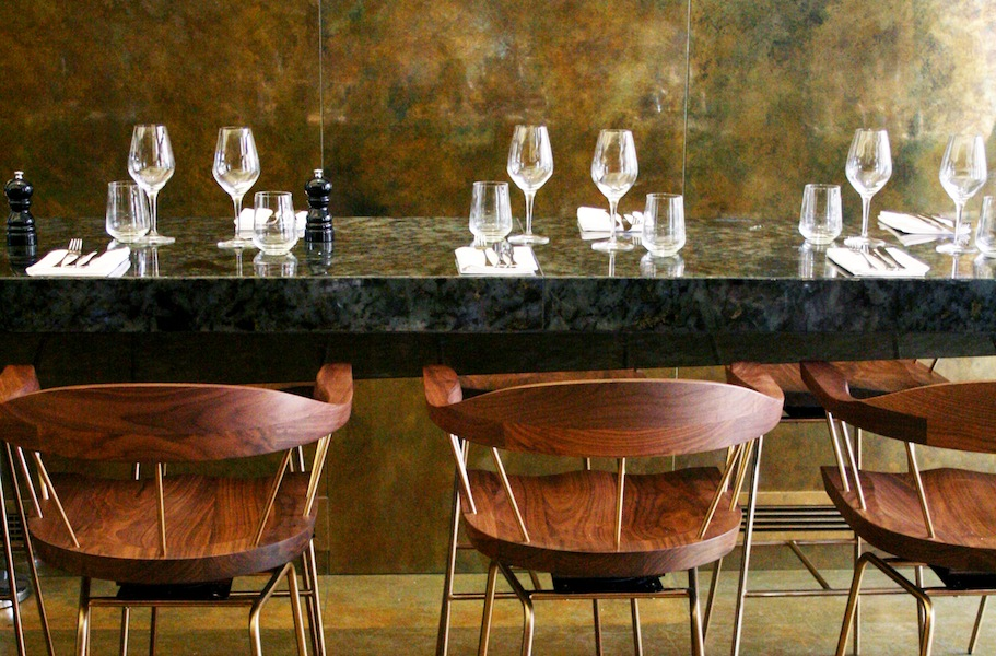 Design elements such as marble tables sans tablecloths keep the ambiance elegant yet relaxed.