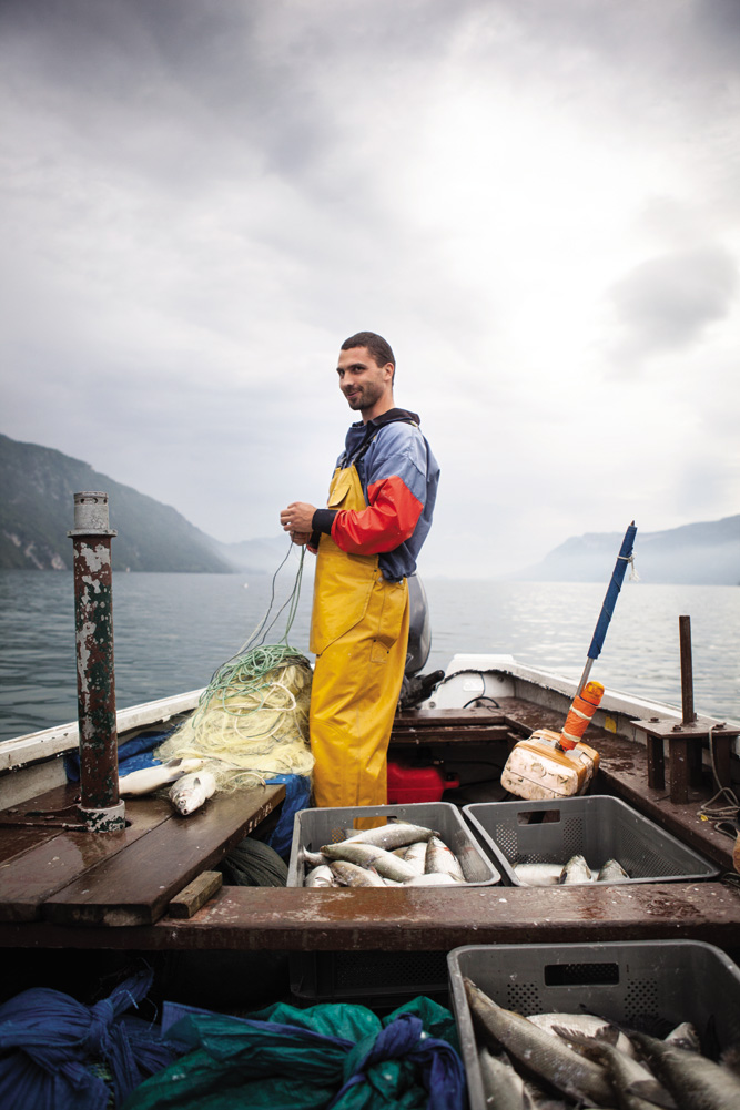 Olivier Parpillon bringing in a catch of lavaret, a fish that appears on the menus of all four of Le Bourget-du-Lac's Michelin-starred restaurants.