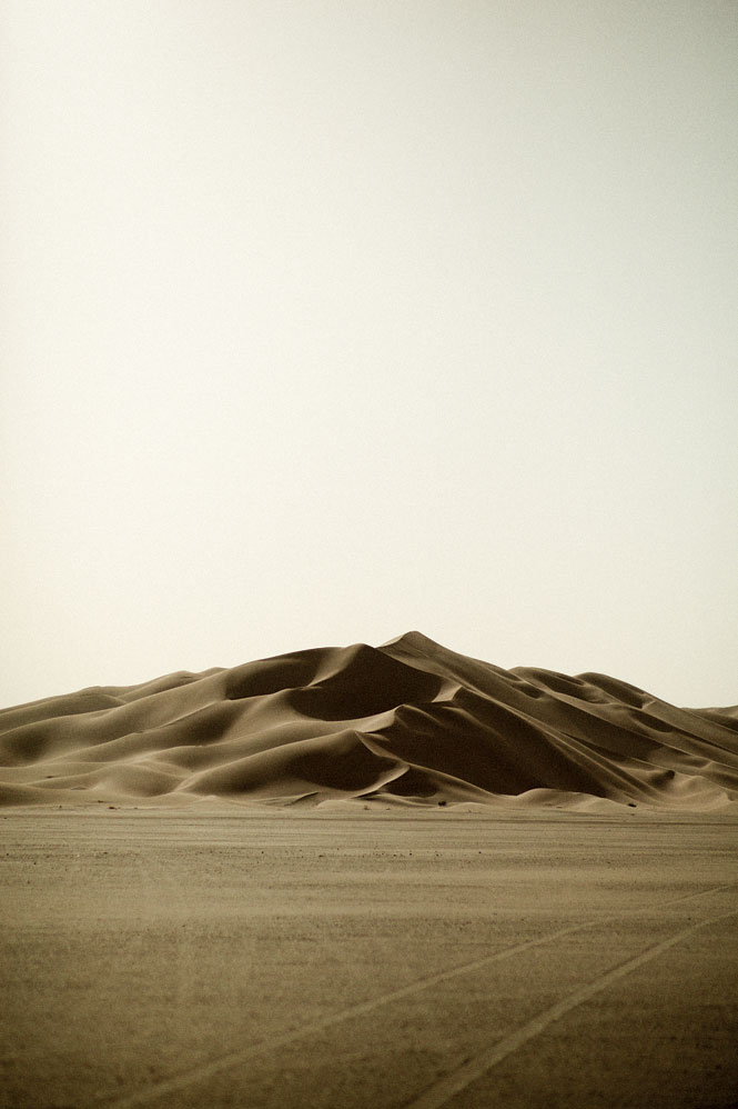 Wind-sculpted sand dunes amid the trackless expanse of southern Oman's Rub' al Khali, or Empty Quarter.