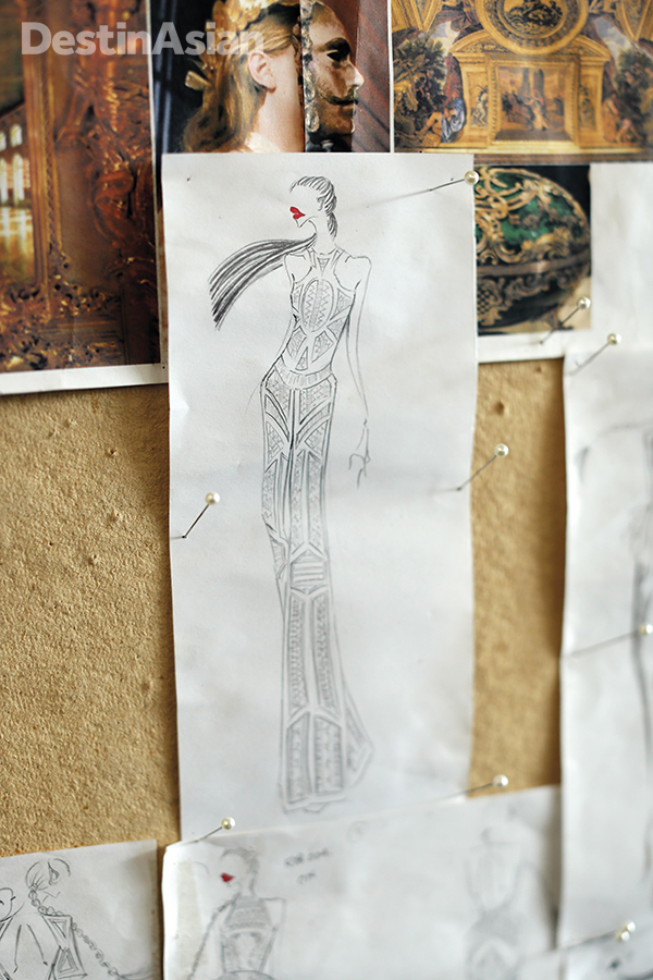 Priyo Oktaviano prepares a new piece with a sketch and a mood board.