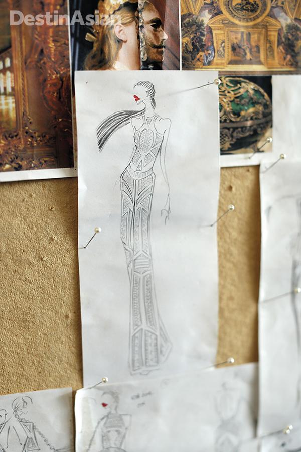 Priyo Oktaviano prepares a new piece with a sketch and a mood board.