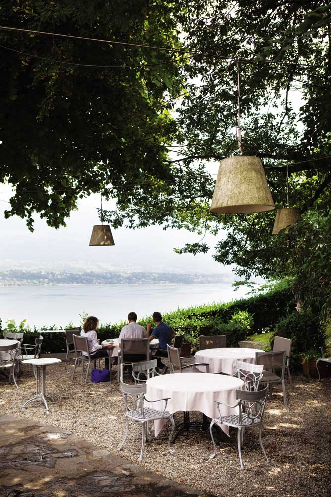 Garden tables at Auberge Lamartine offer the perfect combination of chef Pierre Marin's light, playful cooking and serene views across Lac du Bourget.