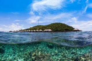 Take in Palawan's expansive views in an above-water villa at Huma Island.