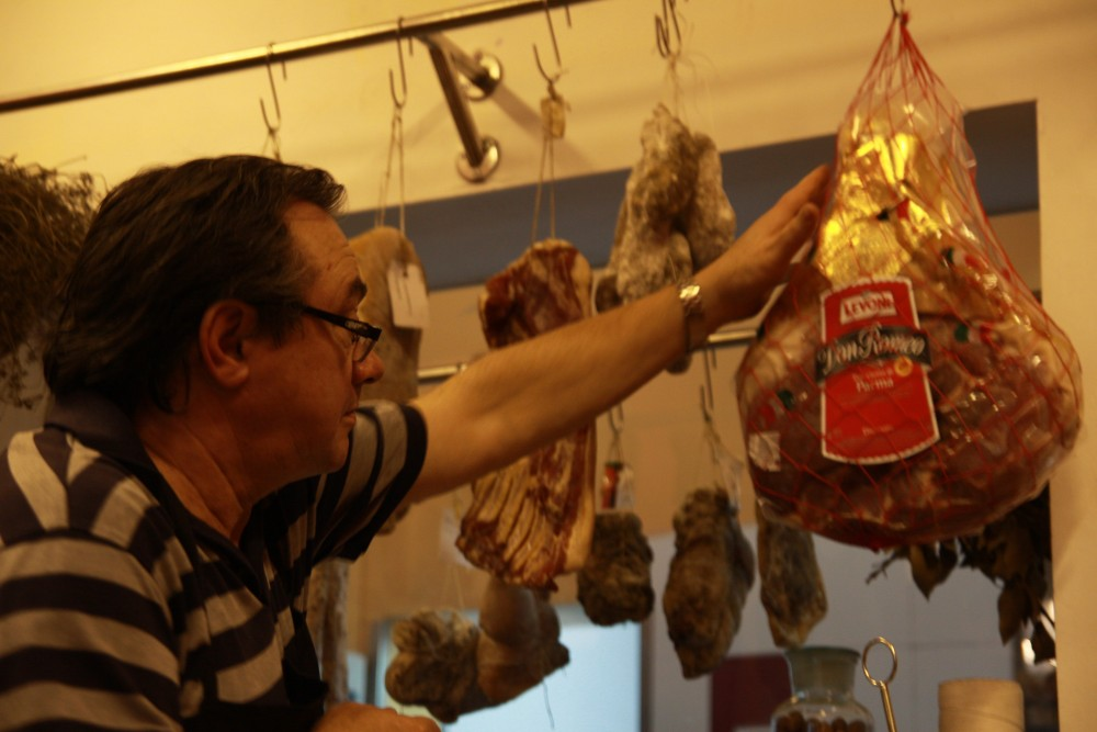 Owner Didier Corlou inspecting some of the store's  wares.