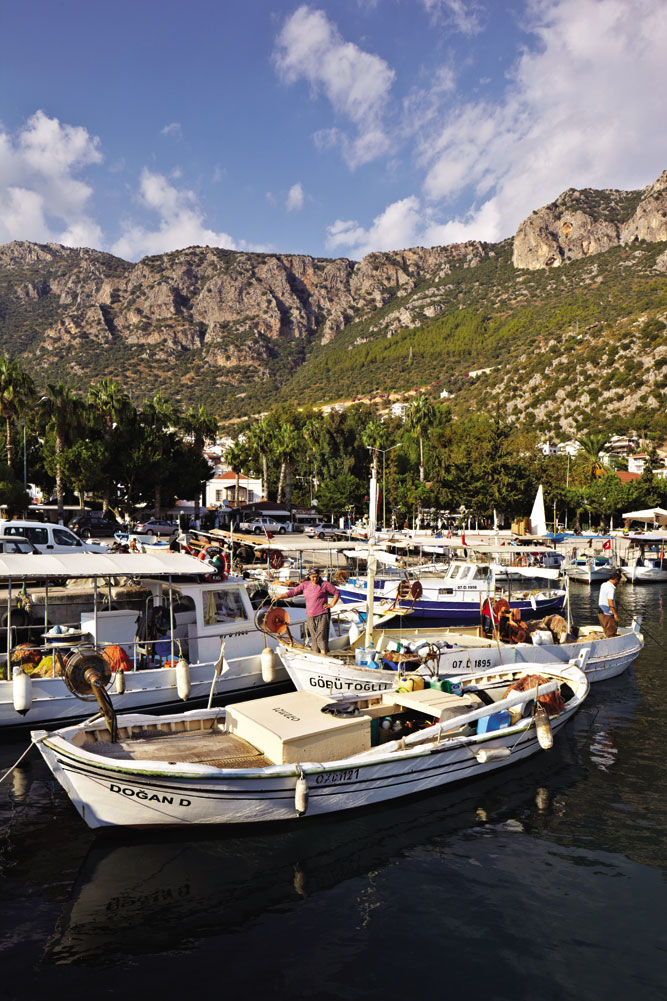 Fishing boats and tourist craft crowd the harbor at Kas.