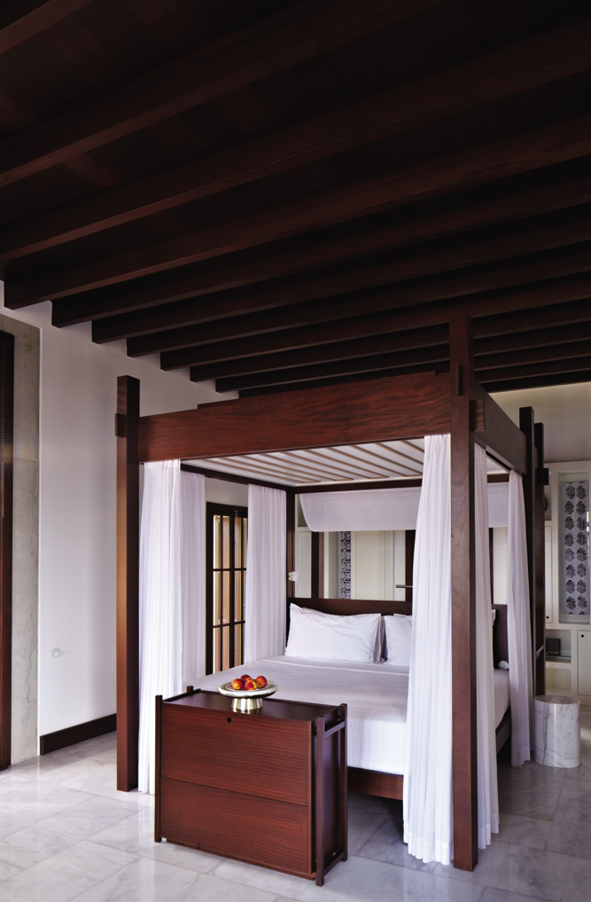 Amanruya 36 stone cottages feature canopy beds and traditional charcoal fireplaces.