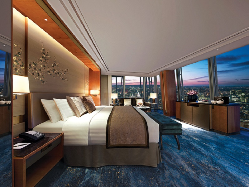 Silk, wood, and thick carpets outfit the Steve Leung-designed rooms.