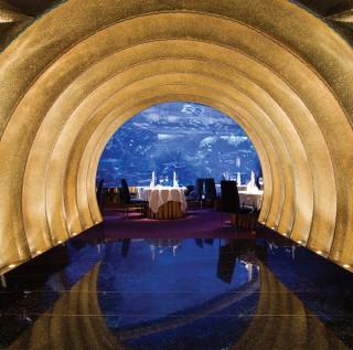 Aquarium-side dining at Al Mahara.