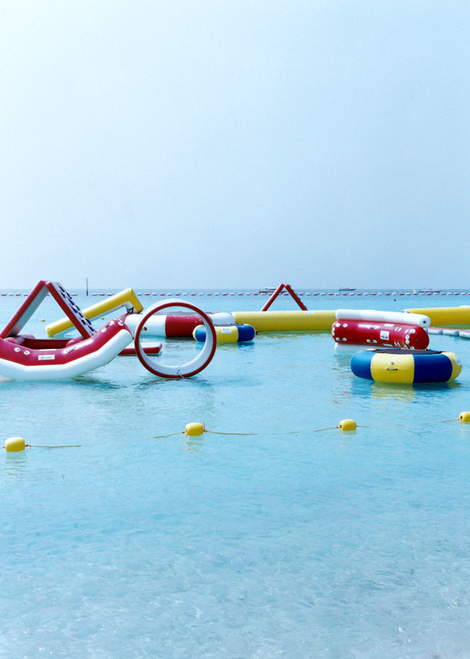 Inflatable accessories in the shallows of Koh Laan, a popular offshore playground.