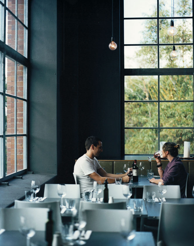 A table for two in the industrial-chic dining room at Bar Alto.