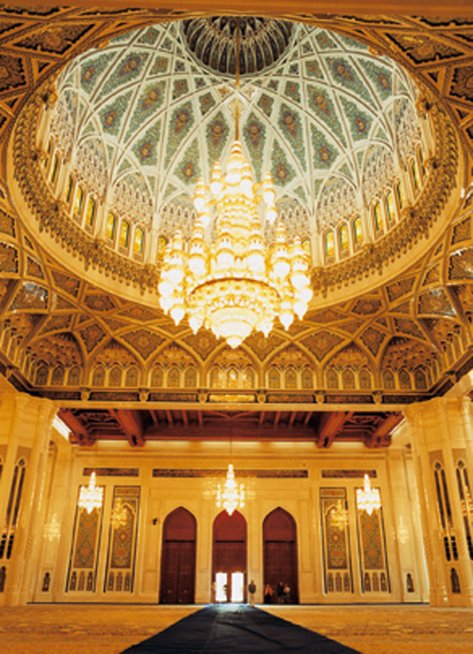 Inside the domed men's prayer hall at the Sultan Qaboos Grand Mosque.