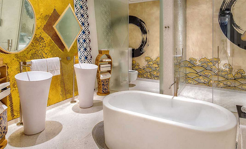 A bathroom at the Villa Siam, which blends Thai culture, Buddhism, and opulent touches.
