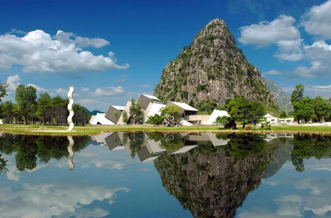 Limestone pinnacles provide the backdrop for Yuzi Paradise's lakefront International Art Center.