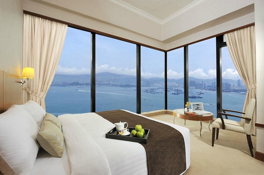 Floor-to-ceiling  glass walls give guests a stunning view of Hong Kong at the city's Island Pacific hotel.
