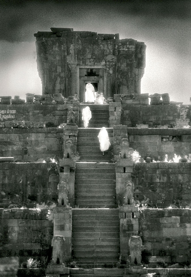 Monks ascending Phnom Bakheng, a ninth-century sanctuary dedicated to Shiva.