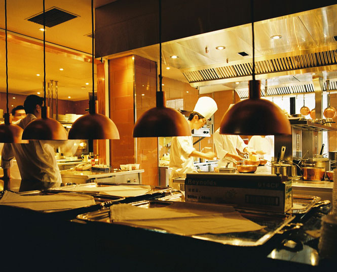 Chefs at work in the kitchen of Jean-Georges, one of four restaurants located at Three on the Bund.