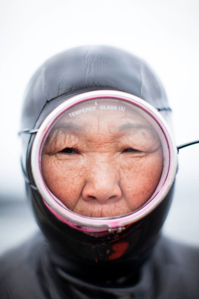 Sixty-four-year-old haenyeo Kim Doo-soon, geared up for the cold waters off Hado village.