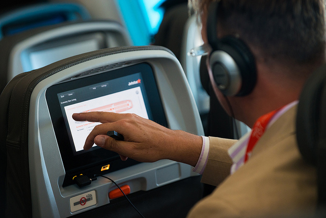 A passenger enjoys Jetstar's in-flight entertainment system.