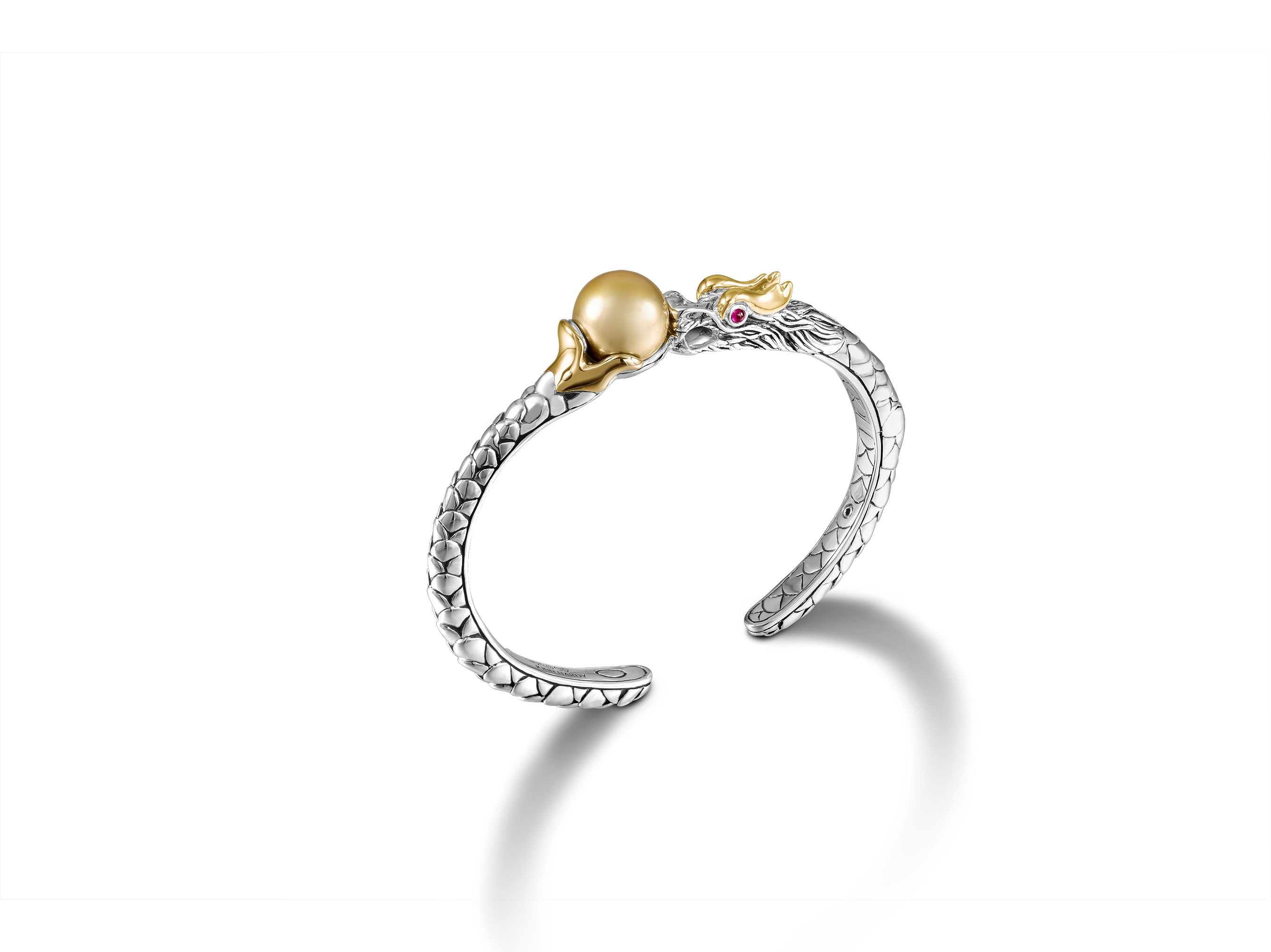 A piece from the new Naga Collection featuring a golden pearl from Lombok.