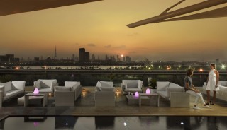 Overlooking Dubai creek from the hotel's Cuba rooftop bar.